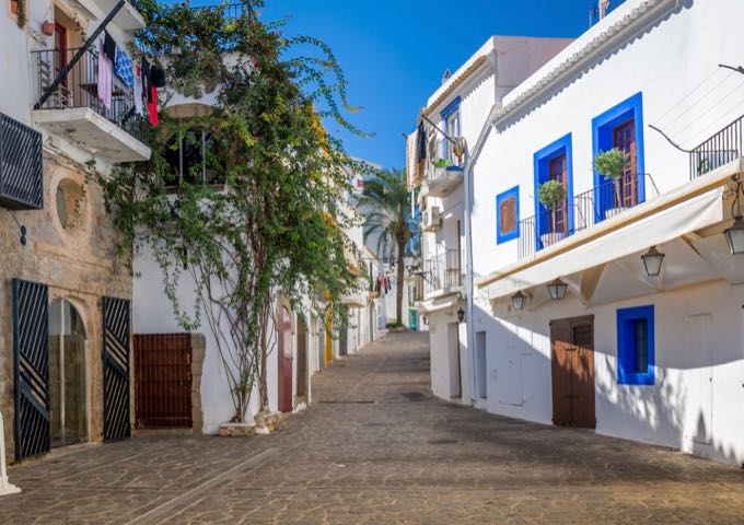 White painted houses on a street in Ibiza Town.