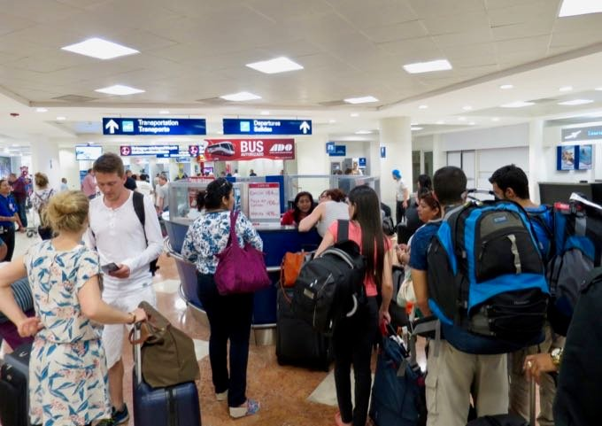 Buying bus tickets to Tulum in Cancun airport.