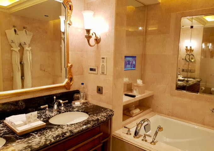 Each suite comes with a spacious marble bathroom.