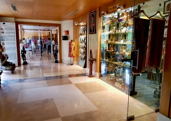 A corridor leads to a few souvenir shops.