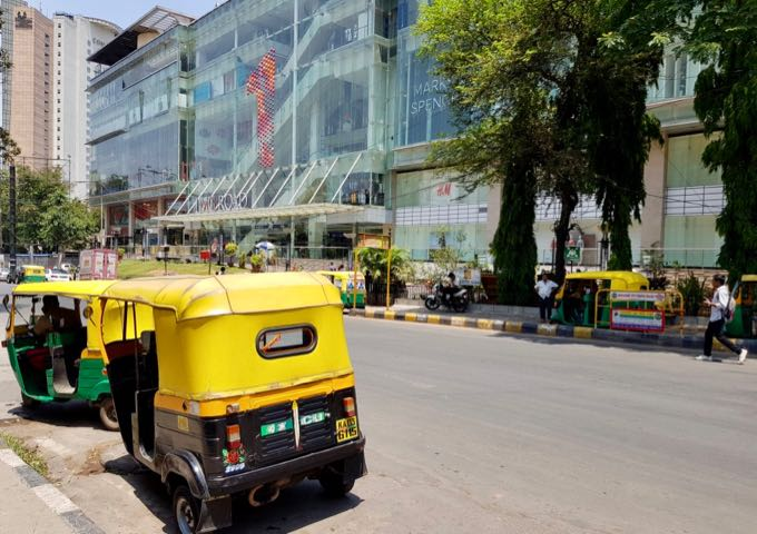 Auto-rickshaws, Uber, and Ola are the most convenient modes of transport.