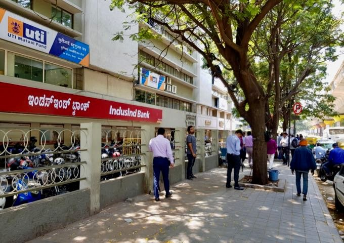 The noisy and polluted M.G. Road has shady sidewalks.