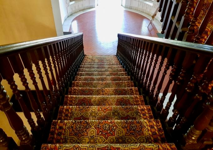 The second floor of the hotel is accessible via staircases lined with plush carpets.
