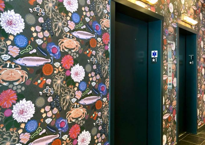 Colorful wallpaper in an elevator bank in Seattle's State Hotel