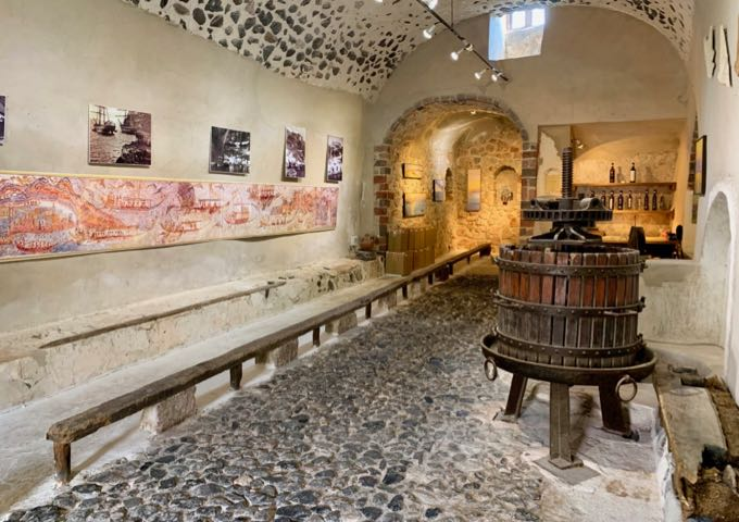Wine museum with old equipment and photographs displayed