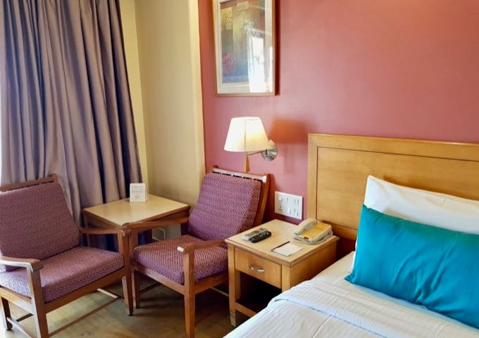 The spacious rooms and suites feature sitting areas.