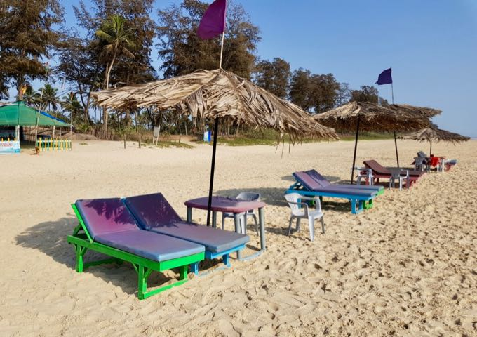 The uncrowded beach features sunbeds on rent.