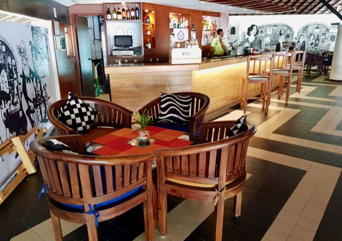 The colorful Amalia bar/lounge is located above the reception.