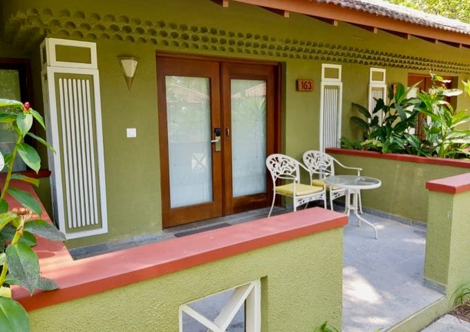 The large balconies/verandas of villas and suites feature outdoor furniture.