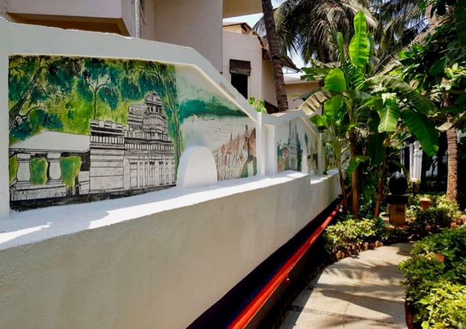 Garden paths with murals of old Goa connect all accommodations.