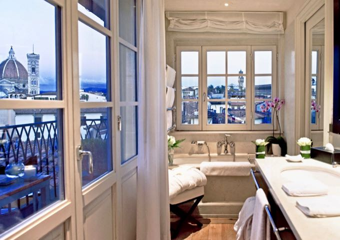 Lavish bathroom with a roll-top bathtub and view of the Duomo in Florence, Italy