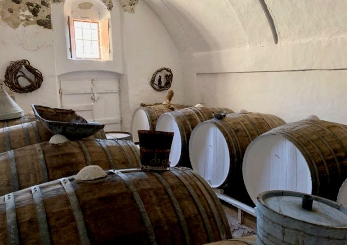 Winery barrel room with stone walls and an open window