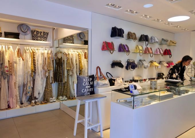 The boutique next door sells women's clothing and accessories.