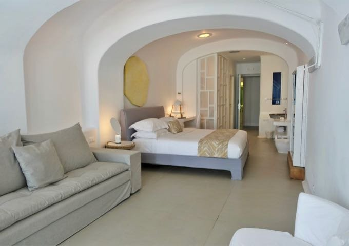 The rooms feature Cycladic architectural elements.