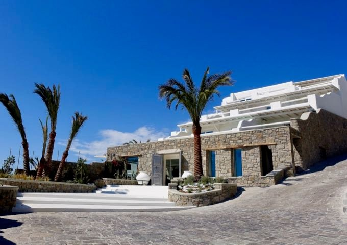 The hotel features a traditional Cycladic architecture.