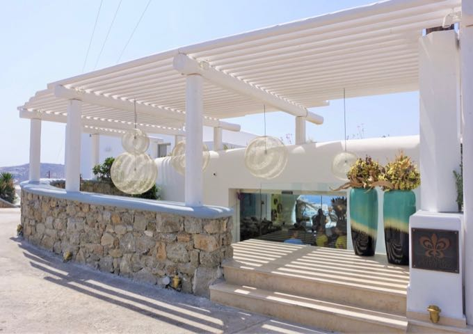 The hotel features contemporary cycladic architecture.