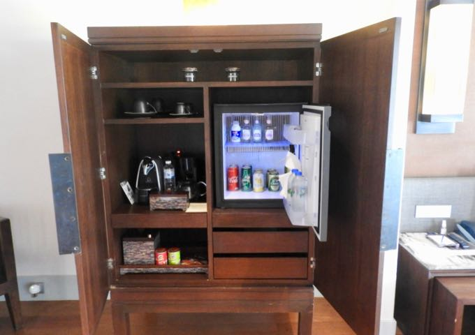The mini bar has a small fridge and a coffee machine.
