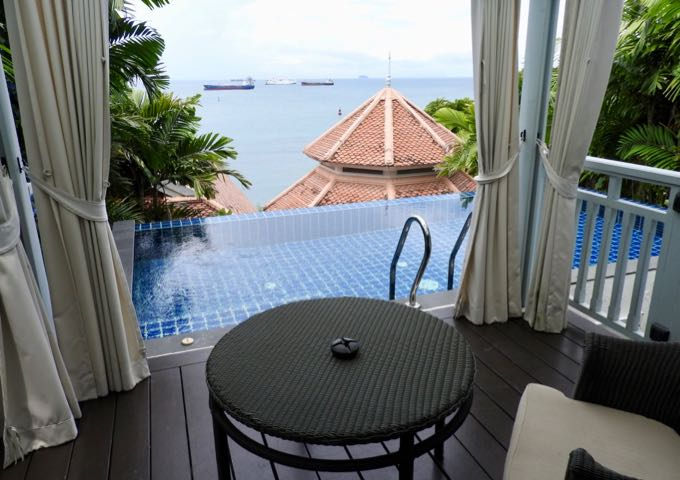 The Pool Pavilion's patio has an infinity pool and small outdoor sitting area.