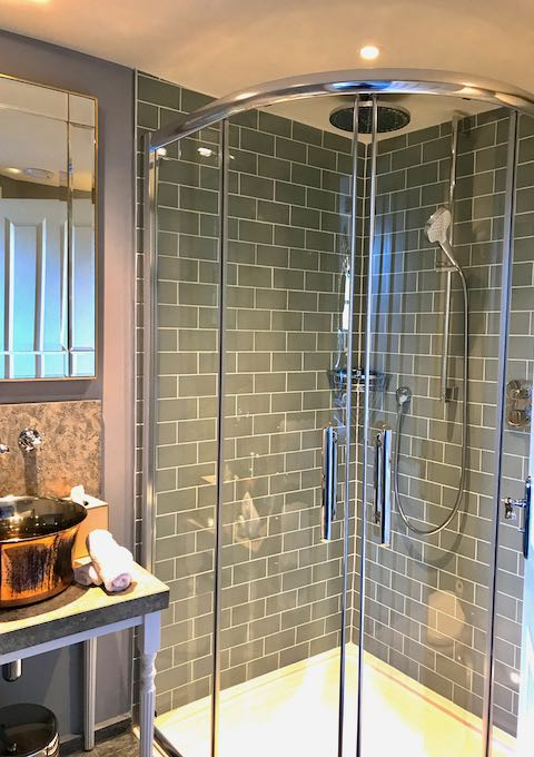 All bathrooms have rain showers and copper wash basins.