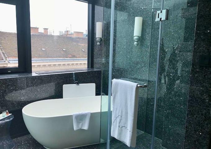 The marble bathrooms feature bathtubs.