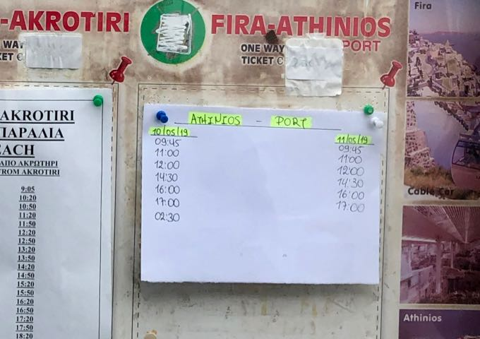 Handwritten notice of the bus schedule to Athinios port on Santorini