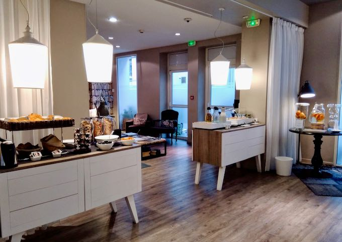 The lounge offers fresh coffee and citrus water.
