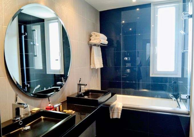 The Rotonde Suite bathroom has twin sinks and a bathtub.