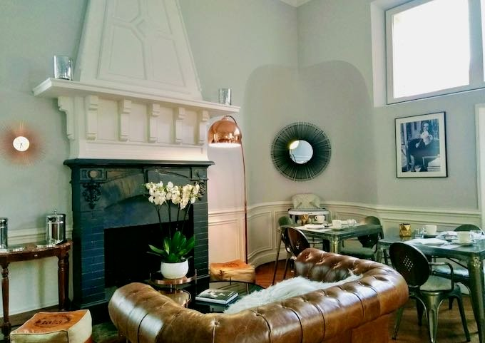 The breakfast room has an elegant fireplace.