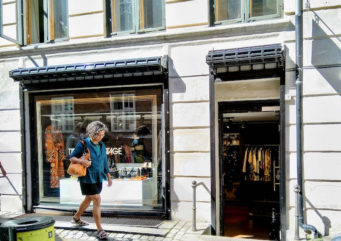 Time's Up Vintage and Henrik Vibskov's edgy fashion boutique are next to each other.