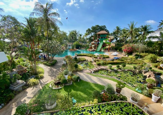Manicured gardens and waterslide resort swimming pool