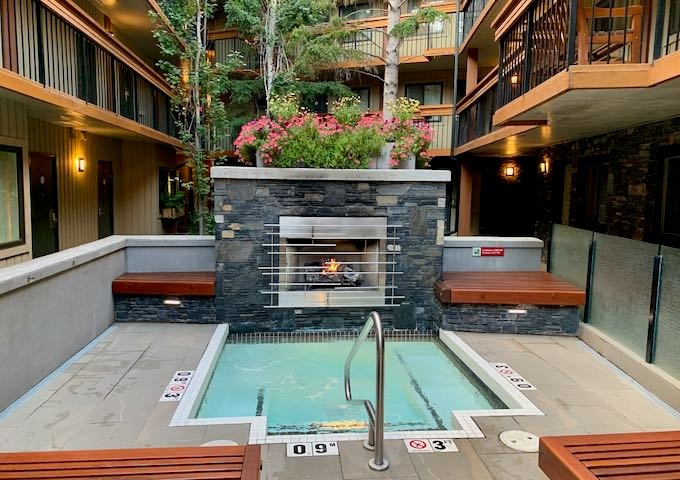 There is a fireplace next to one of the hot tubs.