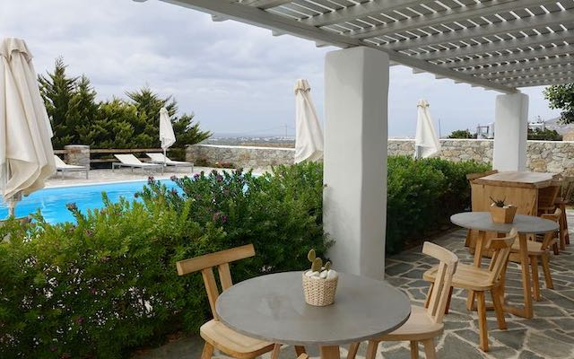 Pool and breakfast terrace at Seven Suites in Naxos