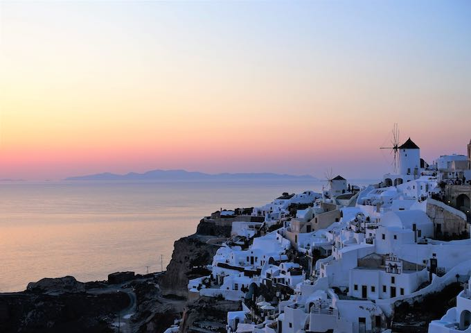 Sunset view with windmills in Oia