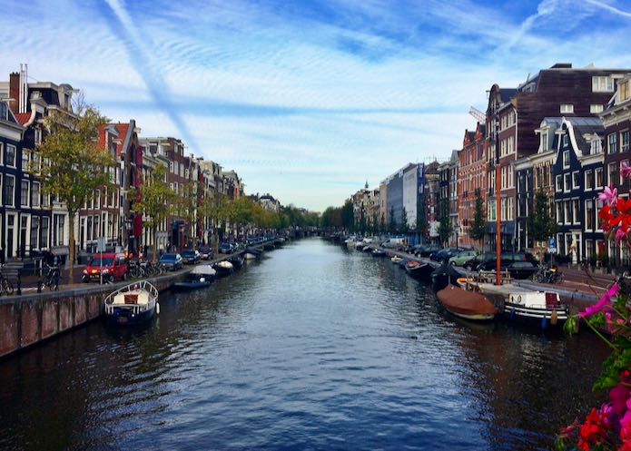 Canal lined with buildings in Amsterdam