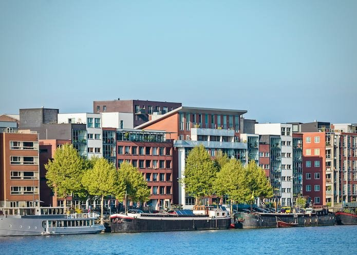 Dutch contemporary apartment buildings in Amsterdam alongside the river IJ at the KNSM island