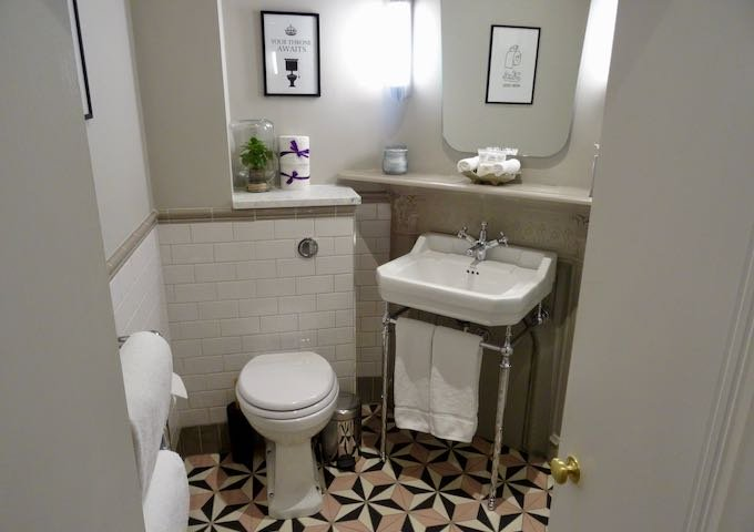 Bathroom are a fusion of period and modern decor.