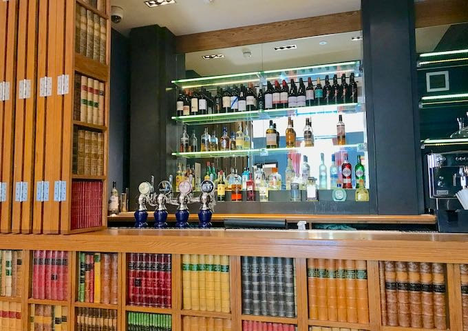 The bar is hidden behind a fake bookcase.