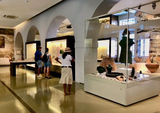 Tourists examine displays at the Archaeological Museum of Nafplio