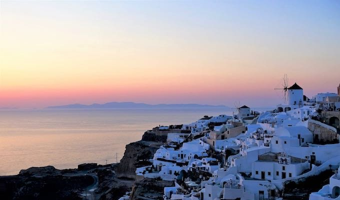 View of the Oia windmills at sunset