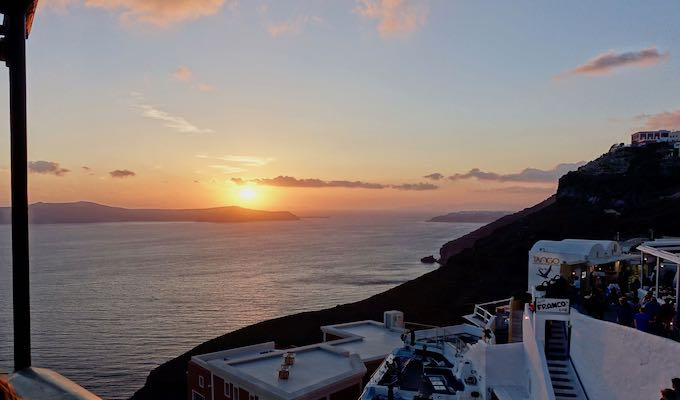 Sunset view in Fira from Tropical Bar with Tango and Franco in view.