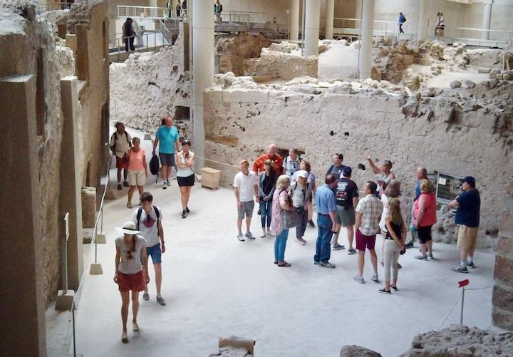 A tour group studies the ruins at Ancient Akrotiri