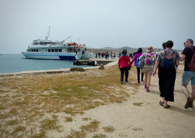 Tourists boarding a boat on Delos Island, bound for Mykonos.
