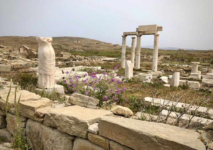Ruins of ancient Greek statues and buildings