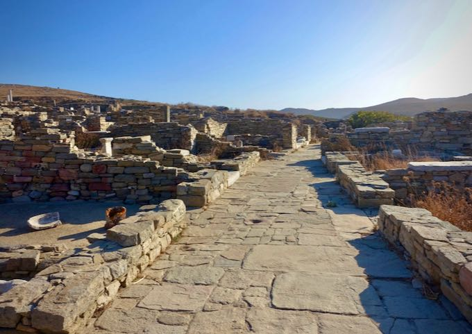 An empty stone walkway surrounded by ancient ruins.