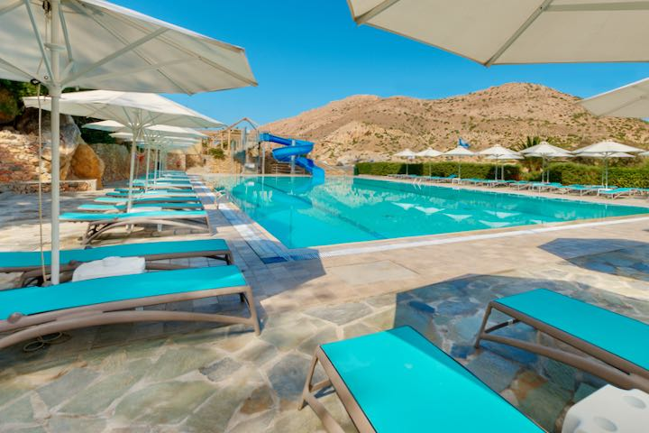 Best beach resort with pool and waterslide for families in Syros.