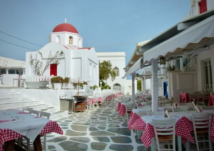 Restaurant with outdoor tables on a white cobbled path