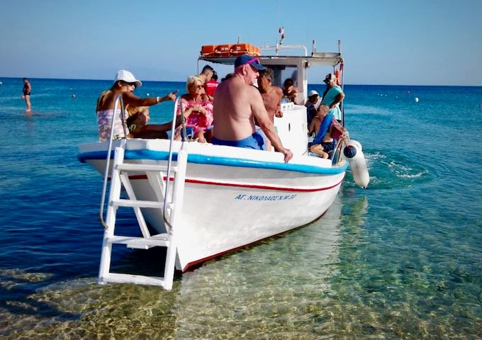 Passengers aboard a water taxi boat in Greece