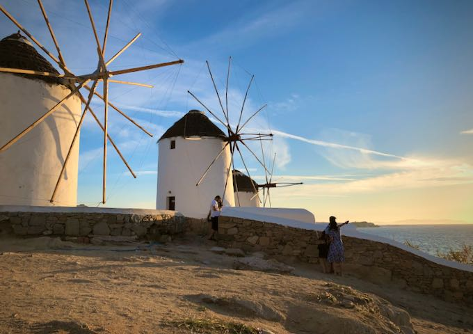 Tourist taking a selfie-photo at the Mykonos Town windmills