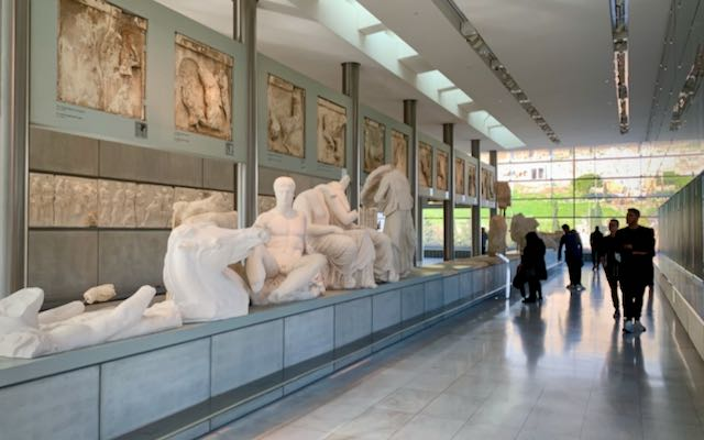 Crowds admire ancient artifacts at the Acropolis Museum in Athens