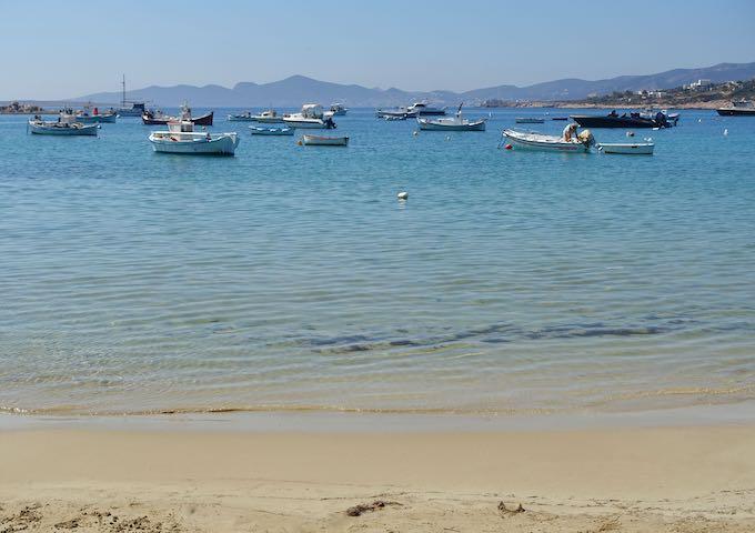 Aliki Beach with fishing boats in Paros, Greece